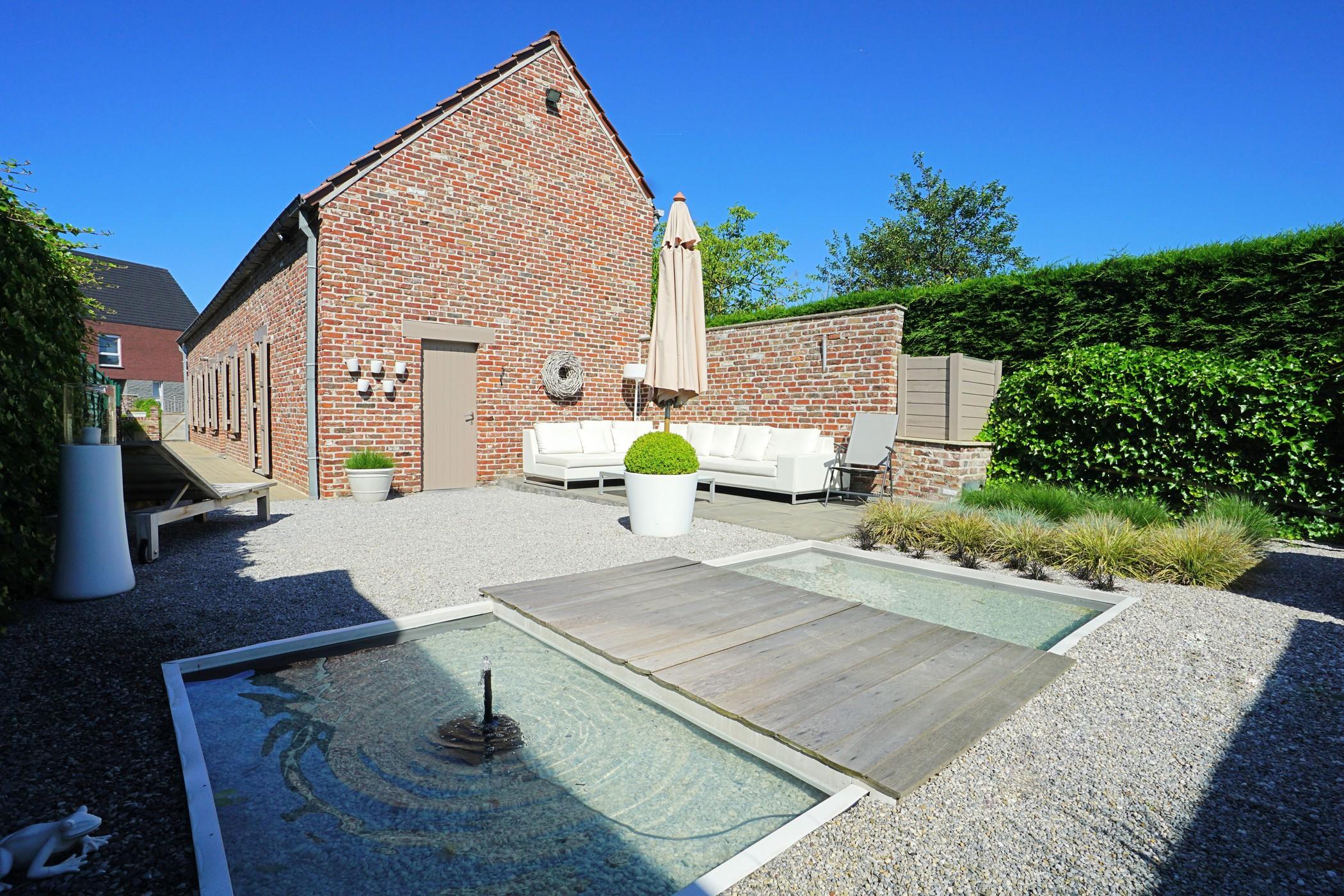 Recent gerenoveerde woning met fraai aangelegde tuin te Nieuwerkerken