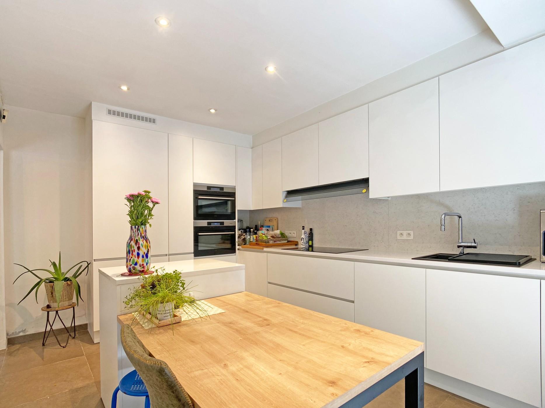 Instapklare bungalow met ruime tuin en garage te Grembergen!